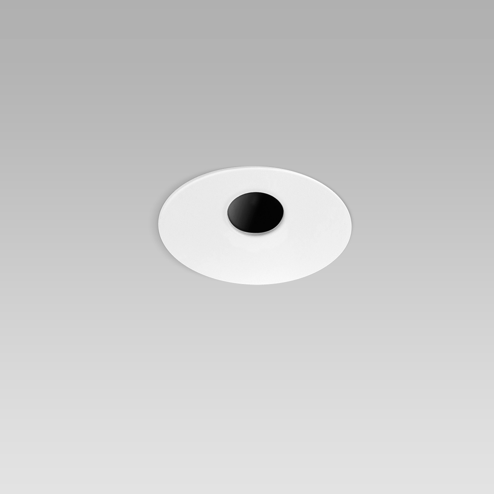Round recessed ceiling downlight for interior lighting with asymmetric pinhole optic